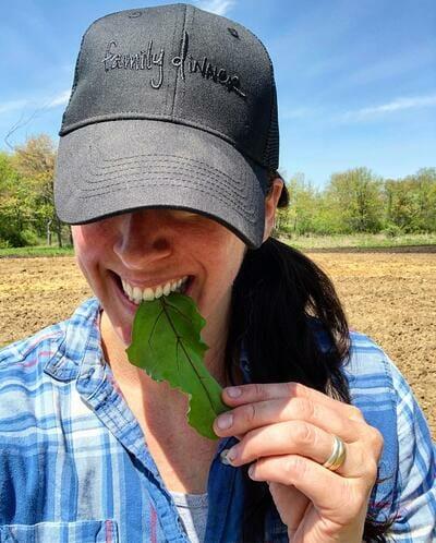 family-dinner-woman-biting-leaf