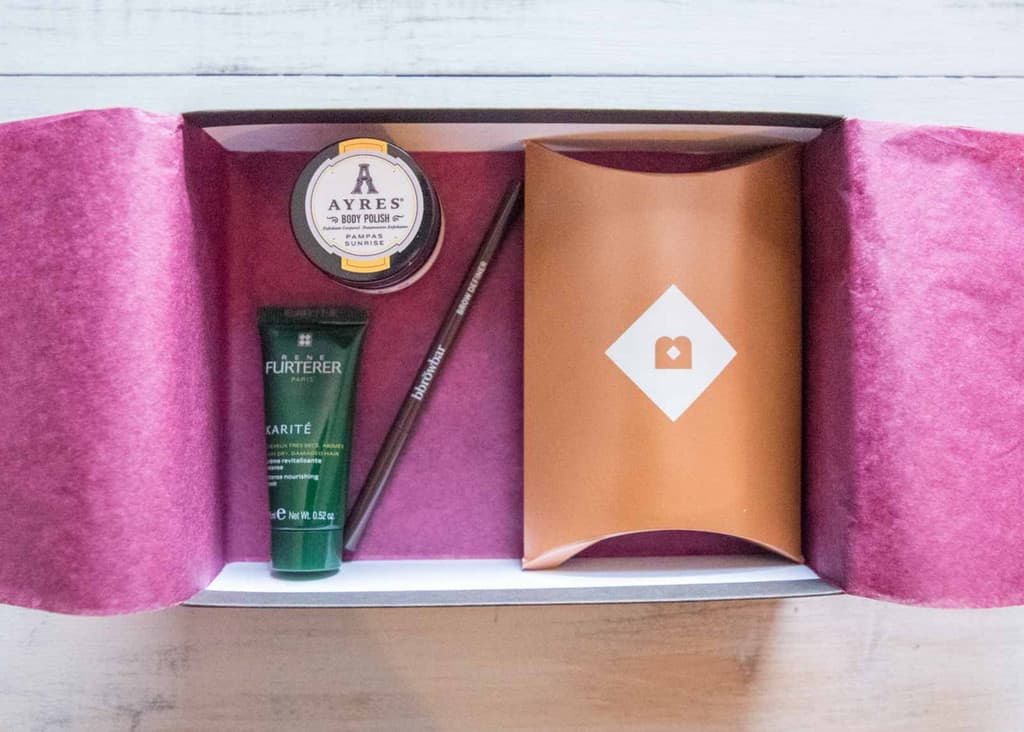 Inside of a Birchbox subscription package with purple wax paper